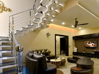 Thematic Living room with staircase :  Living room by shritee ashish & associates