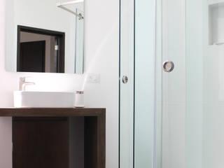 Baños de estilo ecléctico de Molcajete Arquitectura Interiores Diseño Ecléctico