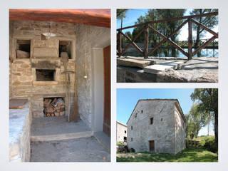Recupero dell'antico mulino ad acqua: Casa di campagna in stile  di Studio Architetto Alessandro Barciulli