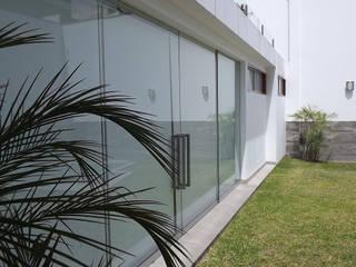 Construcción de casa en Ciudad de México - Casa Coz: Jardines en la fachada de estilo  por GA Experimental