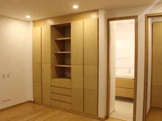 mobiliario: Vestidores de estilo  por IngeniARQ Arquitectura + Ingeniería