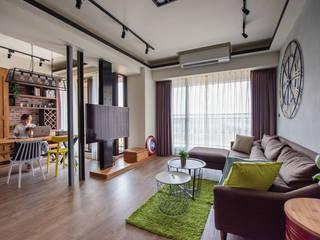 玩工業:  客廳 by 澄月室內設計