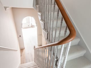 Stairs with wooden balustrade finishes :  Stairs by Prestige Architects By Marco Braghiroli