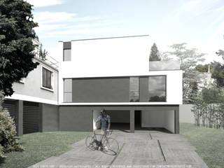 Moradia com estacionamento integrado no edifício por OGGOstudioarchitects, unipessoal lda Moderno