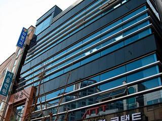 마동 J씨 근생: 인중헌 건축사 사무소의  상업 공간