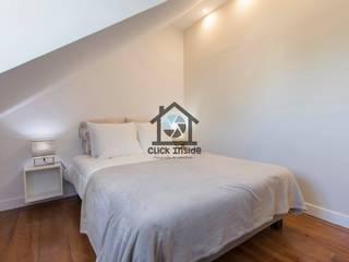 APARTAMENTO EM LISBOA (CASTELO): Quartos modernos por Click Inside - Real Estate Photography