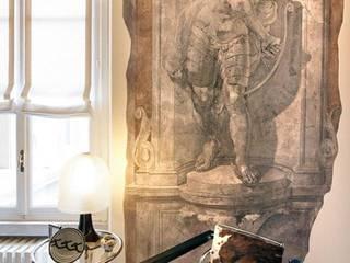 Cadeira pele natural: Sala de estar  por IP Decor Design & Concept