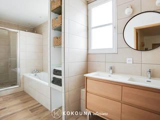 Rénovation d'une salle de bain familiale: Salle de bains de style  par KOKOUNA