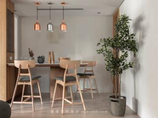 Comedores de estilo asiático de 湜湜空間設計 Asiático