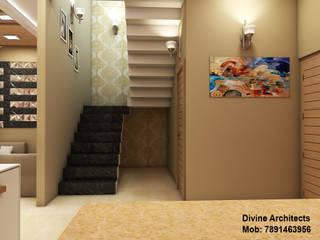 Pasillos, vestíbulos y escaleras de estilo moderno de divine architects Moderno