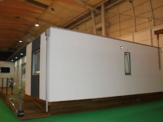 Casa Kitur - Modular Fixa: Casas pré-fabricadas  por KITUR,Minimalista