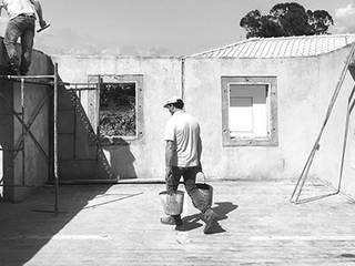2 Apartamentos: Casas  por COMO Arquitectura,Minimalista