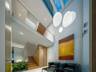 Casa BR: Salas de estilo  por COUTIÑO & PONCE ARQUITECTOS