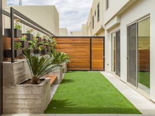Área Exterior CAF: Jardines de estilo  por S2 Arquitectos