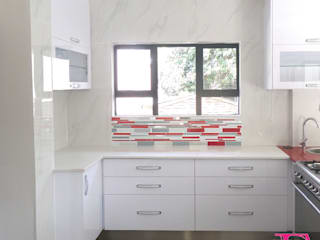 Ultra Modern Kitchen with Red Focalpoint by Ergo Designer Kitchens Modern