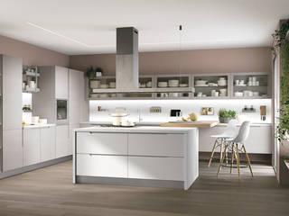 Ilha de cozinha prática e funcional: Armários de cozinha  por Area design interiores - cozinhas em Braga
