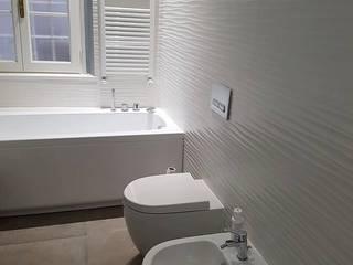 Progetti vari: Bagno in stile  di new life HOME