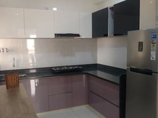 modular kitchen in pu finish with back painted glass by aashita modular kitchen