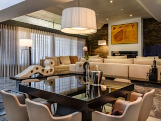 Modern dining room by Oficina Design Modern