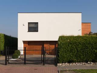 Modernizacja domu kostki: styl , w kategorii Dom jednorodzinny zaprojektowany przez Architekt Adam Wawoczny