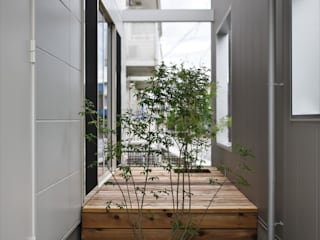 karasaki house ALTS DESIGN OFFICE ラスティックな 庭