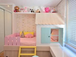 Dormitório de Menina Lúdico por BG arquitetura | Projetos Comerciais Moderno