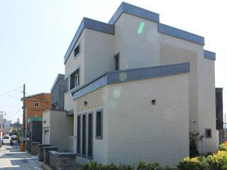 감각적인 모던스타일의 철근콘크리트 주택(충청남도 보령시) 모던스타일 주택 by 더존하우징 모던