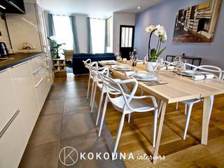 Rénovation d'une salle à manger: Salle à manger de style  par KOKOUNA