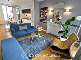 Rénovation d'un salon: Salon de style  par KOKOUNA
