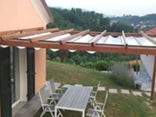 Pergola in legno da esterno con Tenda a Baldacchino di TUTTOLEGNO di Badano Classico