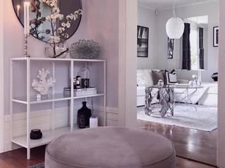 A casa Rosa: Corredores e halls de entrada  por AL Interiores