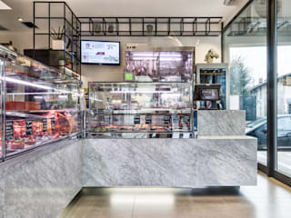 MACELLERIA CONSOLINI Negozi & Locali commerciali moderni di Flussocreativo Design Studio Moderno