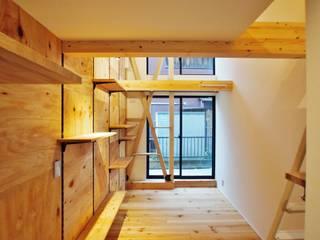 板橋区の共同住宅2: 祐建築設計室が手掛けた寝室です。