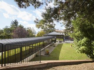 Fondazione Turati Gavinana: Giardino in stile  di Morelli & Ruggeri Architetti