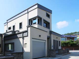 공동마당을 둔 철근콘크리트 주택 (충청남도 보령시) 모던스타일 주택 by 더존하우징 모던