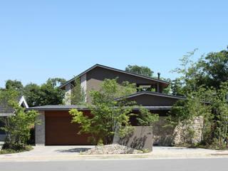 森と暮らす家  -週末住宅-: Studio tanpopo-gumi 一級建築士事務所が手掛けたリゾートハウスです。,