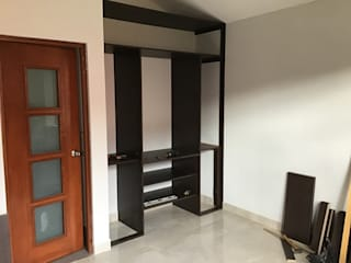 ARDI Arquitectura y servicios Modern dressing room Chipboard Brown