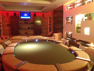 Sala de Poker : Salas de estilo  por MAGIA ARQUITECTONICA