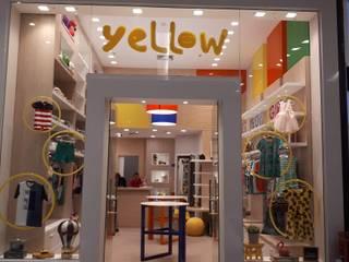 Fachada - Loja Yellow: Shopping Centers  por CASARIO ARQUITETURA E INTERIORES