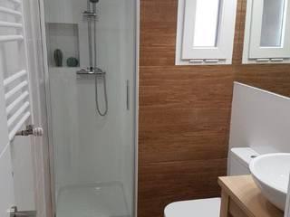 Country style bathroom by GrupoSpacio constructores en Madrid Country