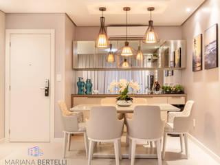 Salas Integradas : Salas de jantar  por Mariana Bertelli Arquitetura e Interiores