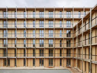 Hagmannareal Residential Building: Condomínios  por Natalia Bencheci,Moderno