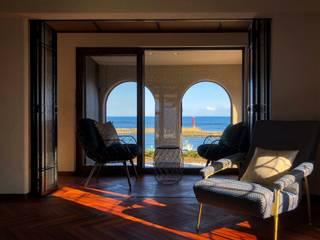 海のPetit Trianon: 金田博道建築研究所株式会社が手掛けたサンルームです。