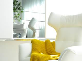 Cadeirão: Salas de estar  por EMME Atelier de Interiores