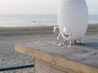 Kooduu am Strandhaus:   von Lothar John Tischkultur