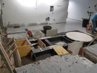 Rehabilitación de una sala de radiología del hospital Marqués de Valdecilla. Hospitales de estilo moderno de MAU CONSTRUCCIONES Y REFORMAS EN CANTABRIA Moderno