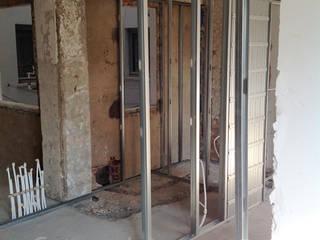 Reforma de vivienda en San Agustín, Burgos.: Puertas de estilo  de Cimbra47