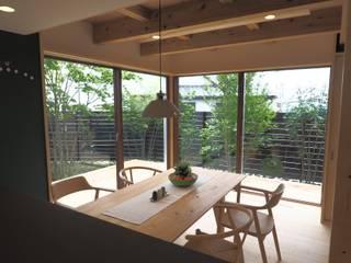 economa Ⅱ[グットデザイン賞]: kameplan architectsが手掛けたリビングです。,