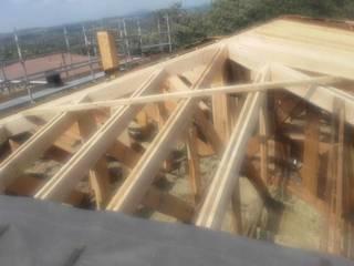 Proceso de reconstrucción: Tejados planos de estilo  de Recasa  S.L.