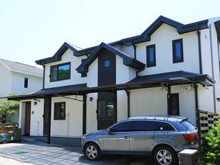 박공지붕의 멋을 살린 목조주택 (경기도 파주시) by 더존하우징 모던